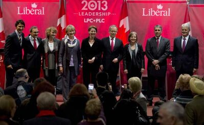 Federal Liberal Leadership candidates Justin Trudeau, left to right, Martin Cauchon, Karen McCrimmon, Joyce Murray, Martha Hall Findlay, George Takach, Deborah Coyne, David Bertschi and Marc Garneau gather for a group photo following a debate in Vancouver, B.C.