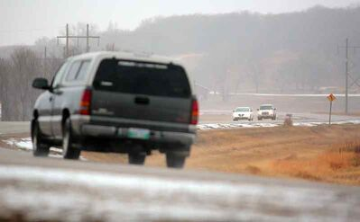 Vehicles travel on Veterans Way in the RM of Cornwallis on Saturday.