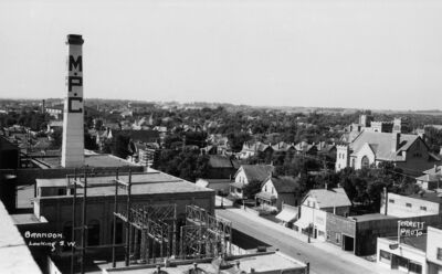 The Manitoba Power Commission steam plant circa 1940, an aerial view of 10th Street facing south from Princess Avenue. Photographer: Jerrett Photo, Joseph H. Huges Collection.