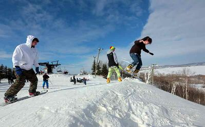 Brian McDonald, right, takes to the slopes as his brother Kevin McDonald, left, and Graham Meyer, centre, enjoy an afternoon of snowboarding at Asessippi Ski Area and Resort on Saturday. The trio travelled from Dauphin to take in the Home Coming weekend celebrations at Asessippi which concluded with a fireworks display Sunday.