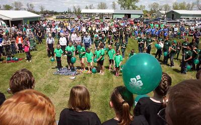 Hundreds of 4-H members sing the national anthem at the Boissevain and Area 4-H Rally on Friday. The rally celebrated 100 years of the organization in Canada.