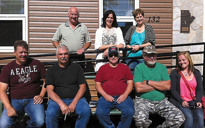 Jim Lockhart (second from the right on the bottom row) was killed in a collision south of Baldur on Wednesday. Lockhart, a councillor for the RM of Argyle, is flanked by officials from the RM. Back row: Reeve Bob Conibear, Coun. Darrian Vermeersch, and CAO Barb Bramwell. Front row: Coun. Daniel Martens, public works officer Don Gudnason, Coun. Tom Kay, Lockhart and Coun. Marilynne Pantel.