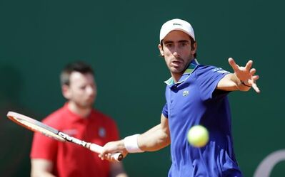Uruguay's Pablo Cuevas returns the ball to France's Lucas Pouille , during their quarterfinal match of the Monte Carlo Tennis Masters tournament in Monaco, Friday, April, 21, 2017. (AP Photo/Claude Paris)
