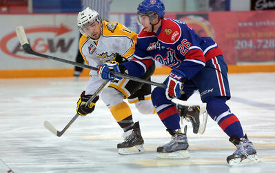 Wheat Kings forward Peter Quenneville tries to pull away while being shadowed by Pats forward Dyson Stevenson in the opening period.