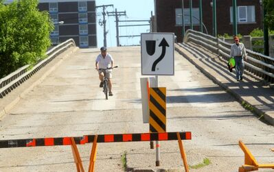 The Eighth Street bridge is still closed to motor vehicle traffic. However, cyclist and pedestrians have been using the bridge regularly.