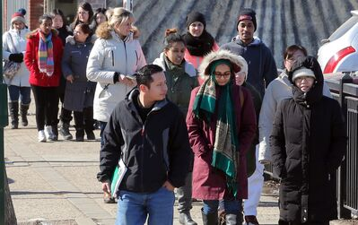 Students from Assiniboine Community College's ESL program make their way along Rosser Avenue on March 1. The students face a disruption of their learning if federal funding is slashed as planned.