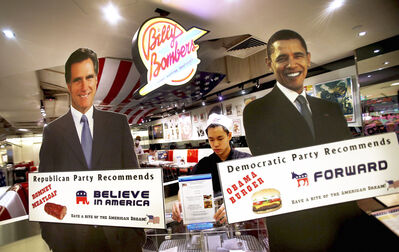 "Life-sized standees of U.S. President Barack Obama, right, and Republican presidential candidate and former Massachusetts Gov. Mitt Romney decorate the entrance of American Diner chain in Singapore, ""Billy Bombers"" Tuesday, Nov. 6, 2012. This American dining chain is giving locals a choice of set meals featuring either the �Obama burger� or the �Romney meatloaf following which, they can ""vote"" for their favorite by placing their voting card in a ballot box next to the pictures of the candidates. (AP Photo/Wong Maye-E)"