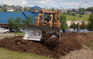A section of the Kirkcaldy Drive dike system was filled in with earth as the city prepares for an influx of water on the Assiniboine River on Wednesday.
