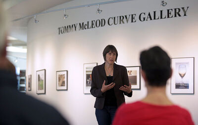"""Dr. Kerstin Roger, a researcher involved with the """"Man-Up Against Suicide"""" exhibit, speaks during an opening reception at Brandon University's Tommy McLeod Curve Gallery on Monday."""
