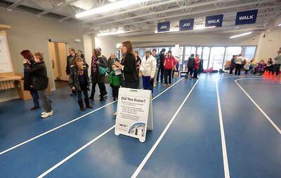 Visitors to the Brandon University Healthy Living Centre make the rounds on the second-floor jogging track during Saturday's open house.