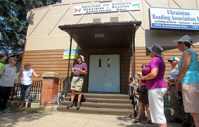 """Local history buff and Brandon Sun columnist David McConkey, centre, leads a tour through the city's north end during Sunday's 13th annual Doors Open heritage tours of the once dubbed """"Brandon's Ghetto."""""""