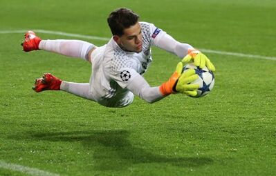 FILE - In this March 8, 2017, file photo, Benfica goalkeeper Ederson makes a save during the Champions League round of 16, second leg, soccer match between Borussia Dortmund and Benfica in Dortmund, Germany. Brazil has been so dominant that it qualified for next year's World Cup in Russia with more than a year to go. But there's a problem. Despite Brazil's overwhelming talent, it lacks a world-class goalkeeper. The candidates are either struggling to play top-level football in Europe, or have little international experience. (AP Photo/Michael Probst, File)