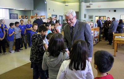 Premier Greg Selinger meets with Grade 3 and 4 students from École New Era School on Tuesday after announcing provincial funding for the Canadian Red Cross' Beyond the Hurt anti-bullying program.