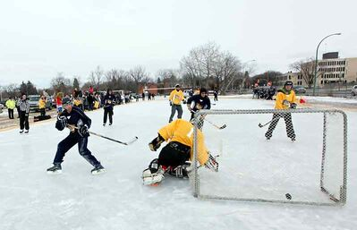In this February 2012 photo, the Brandon University faculty scores a goal during their hockey game against BU students at Winterlude at Brandon University. This year's daylong event, which will be held on Saturday, kicks off with a free hot breakfast in the university's main dining hall at 10:30 a.m.