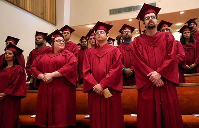 Students wait to receive their diplomas during the Assiniboine Community College Adult Collegiate's graduation ceremony at McDiarmid Drive Alliance Church on Saturday.