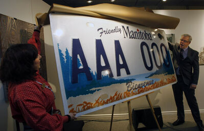 Premier Greg Selinger and Ginette Lavack Walters, executive director of Festival du Voyageur unveiled the design this morning of the new bilingual licence plates.