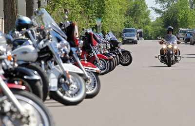 A motorcyclist pulls into the Brandon Armoury at the end of the third annual Defenders Motorcycle Club's Memorial Motorcycle Ride on Saturday afternoon.