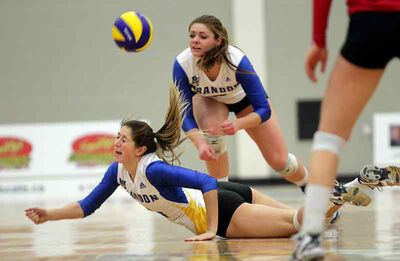 Chloe Reimer of the Brandon University Bobcats dives for the ball as Shanlee McLennan looks on Friday night.