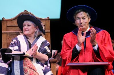 Brandon University president Deborah Poff and Canadian Ambassador to the United States Gary Doer applaud during the university's 100th convocation ceremony in 2011.