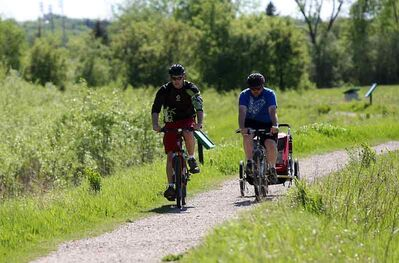 A pair of cyclists along the duck pond trails at the Riverbank Discovery Centre in 2010.
