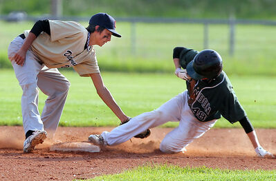 Diamond Dawgs infielder Lane Anderson tries to put the tag on Brandon Midget Knights baserunner Jordan Robertson at second base during Andrew Agencies Senior AA Baseball League action on Monday night at Brandon Field.