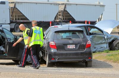 Brandon police attend the scene of a 3 vehicle collision at the intersection of 18th Street North and the Trans Canada highway, Thursday morning.