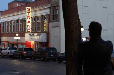 People watch the lights of the Strand Theatre after a ceremony last month to kick off a $700,000 fundraising effort toward the building's renewal as a community performance and arts centre.