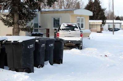 Rows of city garbage collection bins stand at the south end of Kingsway Kort on Monday.