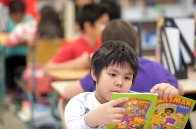 King George School student Tray Contois, above, reads in class on Wednesday.