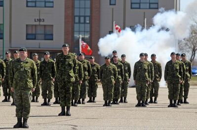 "Smoke from the ""minute gun"" hangs in the air as soldiers representing the various units deployed during the Afghanistan missions mark a moment of silence during Friday's National Day of Honour at CFB Shilo."