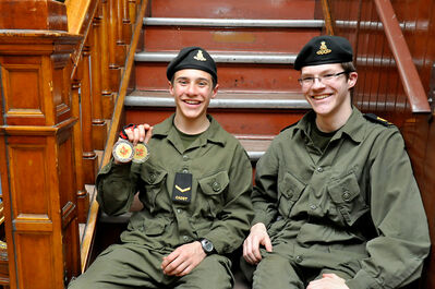Gunner Connor Browett holds Provincial Marksmanship gold and bronze medals with fellow provincial contender Warrant Officer Colin Lowrie.
