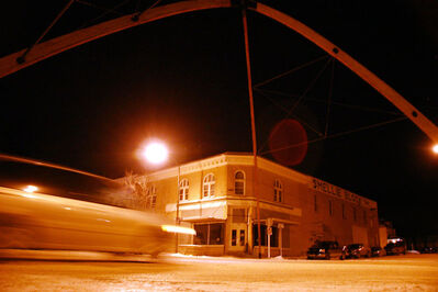 The wooden arches along Russell's Main Street seen here at night.