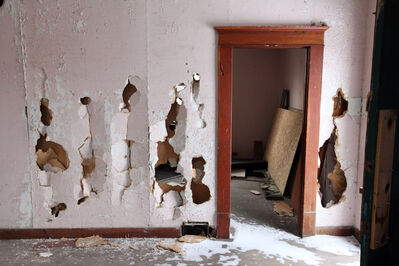 Smashed walls are visible in one of the homes at the Criddle-Vane Homestead south of CFB Shilo after vandals caused damage to the provincial heritage park.