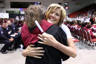 ACC Practical Nursing graduate Jaime Billaney hugs a faculty member after receiving her diploma during Assiniboine Community College's 2012 Graduation Ceremonies. The popular program has a two-year wait list —and the college isn't taking any new names.