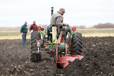Gene Sache of British Columbia eyes his row while preparing for the 2012 Canadian Plowing Championships on Wednesday near Kemnay.
