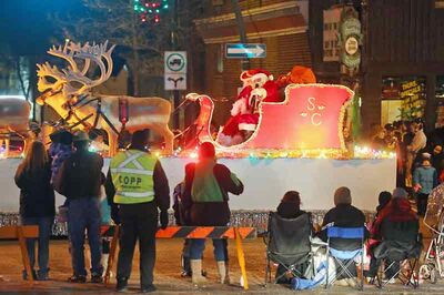 Santa Claus waves to the crowd on Rosser Avenue as the annual Wealth Planning Group Brandon Santa Parade comes to an end on Saturday evening.