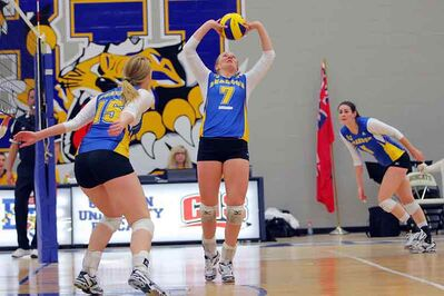 Kellie Baker (7) of the Brandon University Bobcats sets the ball during university women's volleyball action against the University of Calgary Dinos at the BU Healthy Living Centre on Saturday evening.