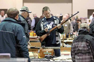 A visitor checks out one of the firearms on display at the Brandon Wildlife Association's Gun and Collectibles Show at the Keystone Centre on Sunday.