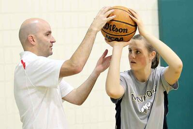 NBA shooting consultant Dave Love gives Shayna Mathison of the Hamiota Huskies some tips during a basic shooting mechanics clinic at the Neelin High School gymnasium on Sunday morning.