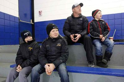 Hockey fans Nolan Ritchie, Rylan Thiessen, Derek Thiessen and Carter Thiessen watch the Midget AAA Brandon Wheat Kings take on the Interlake Lightning at the Sportsplex on Sunday. Most local hockey fans were happy to see a settlement reached in the lockout but they remain frustrated by the long negotiation process.