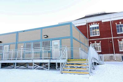 A portable classroom sits adjacent to École New Era School. The Brandon School Division is hoping to add 12 more portable classrooms.