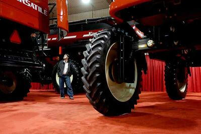 A visitor to Manitoba Ag Days checks out the Versatile display on Tuesday. The event runs through Thursday.