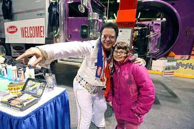 Earl Oxford School student Deanna Lockie poses for a photo with Elvis impersonator Kevin LaFlamme during Manitoba Ag Days, which kicked off on Tuesday.