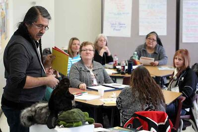 Dan Thomas of the Manitoba First Nations Education Resource Centre speaks to a group of Westman teachers during a training session focusing on treaty education at Brandon University on Tuesday.