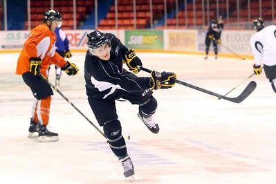 Brandon Wheat Kings captain Ryan Pulock takes a shot at Westman Place in his first practice in two weeks.