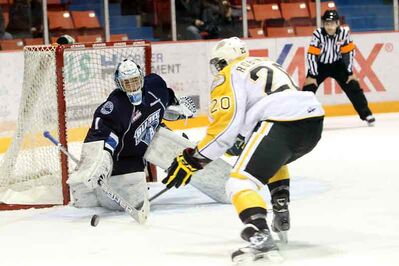 Brandon's Chad Robinson is stopped by Saskatoon's Andrey Makarov on Wednesday night at Westman Place.