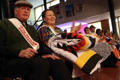Jacqueline Sinclair shares a laugh with fellow pavilion ambassador Drew Mills at the opening ceremonies for the 10th annual Lieutenant Governor's Winter Festival on Thursday evening at city hall.