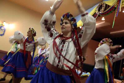 Dancers take the stage at the Ukrainian pavilion on the opening night of the 10th annual  Lieutenant Governor's Winter Festival on Thursday.
