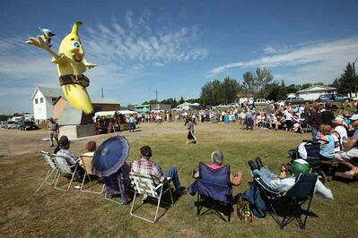 Residents and out-of-towners alike take in the unveiling ceremony for the nine-metre-high banana statue in Melita in 2010. The statue will be re-installed today after having to undergo repairs.