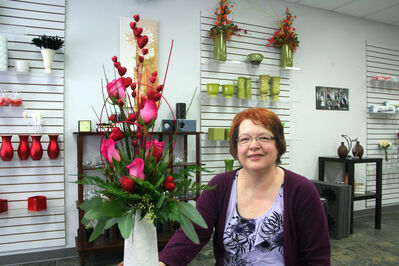 Carolyn Kruger has had a passion for flowers for almost as long as she can remember. She grew up in Brandon and, over the years, has worked at almost every floral shop in town. She's spent 15-plus years in the business, and for the past two-and-a-half years has been running her own establishment, Carolyn's Floral Designs, at 726–18th Street in the Thomas Mall.